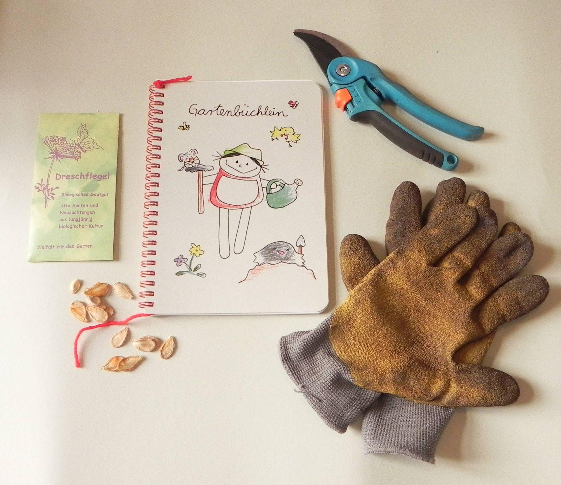 nini ne Gartenbuch zum SElbergestalten für Beete und Hochbeete, Bild mit Gartenhandschuhen, Gartenschere und Samen