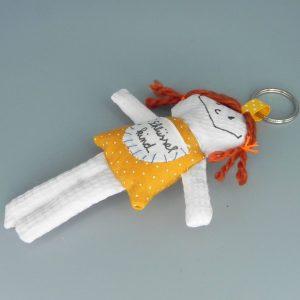 Schlüsselanhänger in orange mit kleinen weißen Punkten und orangebraunen Haaren
